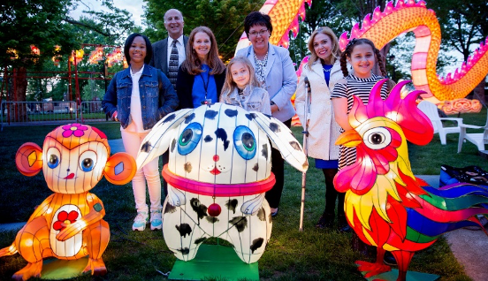 Lantern contest winners posed with the lantern versions of their designs made by Tianyu.